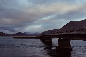 Bridge over Fjord and Dark Clouds