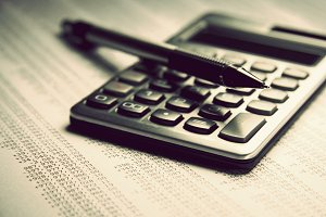 Closeup of calculator and pencil
