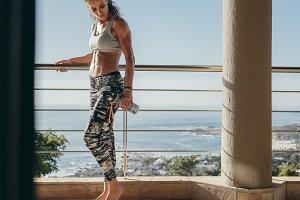 Muscular female in balcony