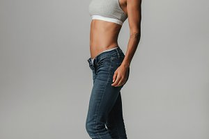Pretty athletic woman with jeans