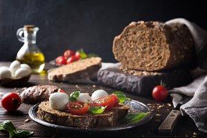 Open sandwich with tomato, mozzarella and basil