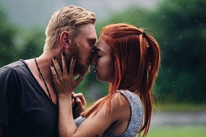 beautiful couple kissing in the rain