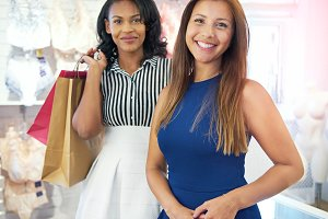 Two multiracial young women shopping