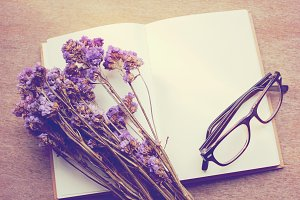 Eyeglasses on blank notebook
