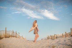 Women dancing on a beach
