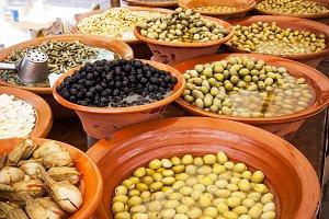 Marinated olives on street market