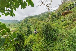 man going on zipline adventure