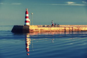 Couple with bicycles. Baltic