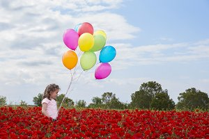 Girl, balloons and poppies
