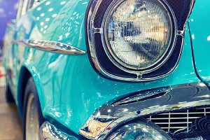 retro american car headlight close-up toning. point of view
