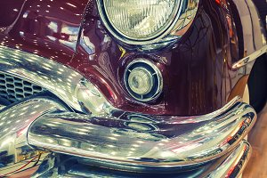 Color detail on the headlight of vintage american car.