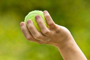 woman hand holding tennis ball