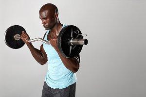 Young muscular man exercising
