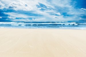 Beach under blue sky.