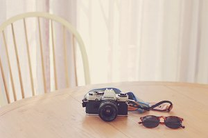 film camera and sunglasses