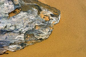 Stone on the yellow sand