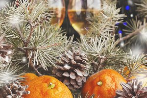Christmas balls with fir branches and glasses of champagne