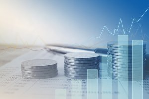 graph and coin finance concept