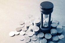 coin money and hourglass