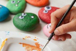 Child painting stones