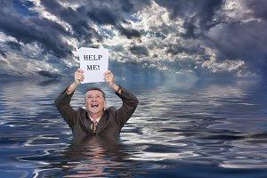 Senior man drowning in paperwork