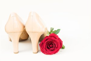 Nude colored high heels still life