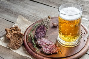 Saucisson sausage with glass of beer