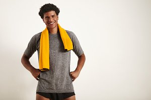 Smiling handsome black athlete with a towel over his neck