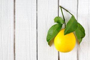 Lemon on white wood