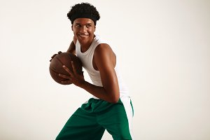 Young smiling black athlete playing basketball