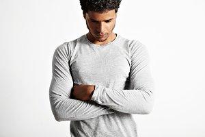 Young sexy black model wearing light gray longsleeve t-shirt