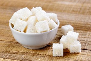 White sugar cubes in bowl