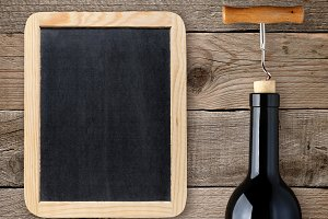 Wine bottle and blank chalkboard