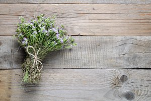 Thyme on wooden background