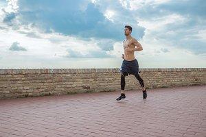 young man running jogging shirtless