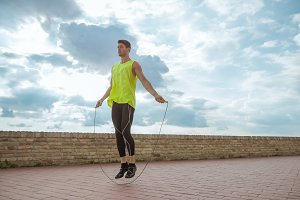 young man jumping rope athlete