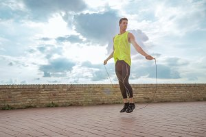 young man jumping rope lens flare