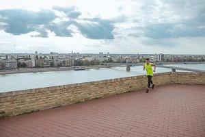 man fitness jogging city panorama