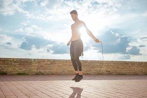 jumping rope young man sun sky sunny