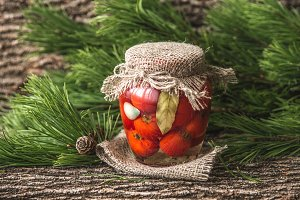 Marinated tomatoes in the glass jar
