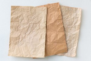 old three brown crumpled paper