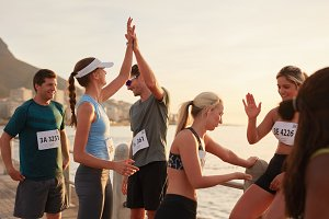 Athletes high fiving after a race