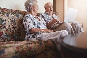 Elderly couple relaxing on sofa