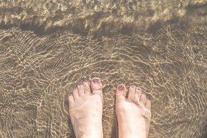 Feet in the water M