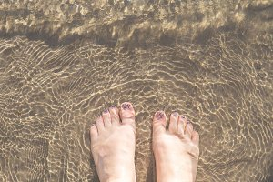 Feet in the sand L
