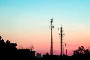 sunset sky with silhouette antenna