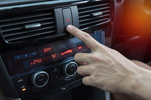 man hand turn on car engine