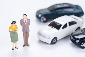 miniature people with many car