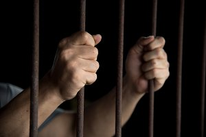 Hands of the prisoner in jail