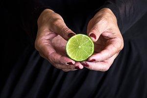 Lemon in woman hand